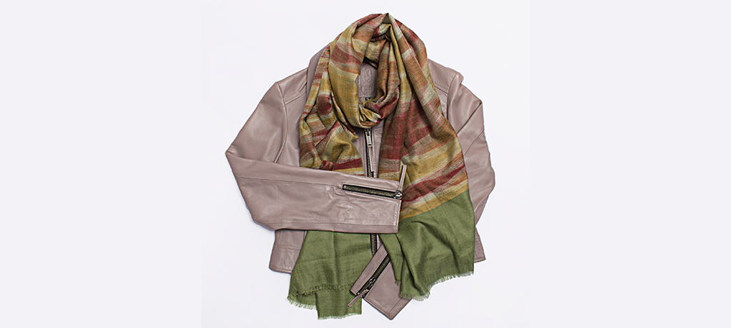 The Secret Room Boutique flat lay with bovine leather jacket and cashmere scarf